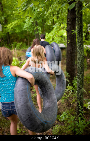 Teenagers carrying innertubes - Stock Photo