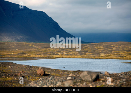 Glacial lake, mountainous landscape near Höfn, southeast Iceland - Stock Photo