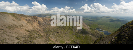 Panoramic view from the ridge leading to the summit of Snowdon looking down the Afon Glaslyn valley along Crib Goch, - Stock Photo