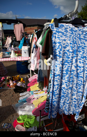 rail of 2nd hand womens clothes for sale at a car boot sale in newtownabbey northern ireland uk - Stock Photo