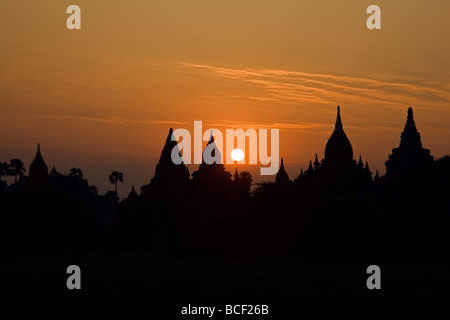 Myanmar. Burma. Bagan. Sunrise over ancient Buddhist temples on the central plain of Bagan. Founded in 1044. - Stock Photo