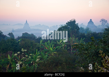 Early morning mist shrouds the historic temples of Mrauk U, built in the Rakhine style between the 15th and 17th - Stock Photo