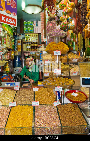 Turkey , Istanbul , Spice Market or Misir Carsisi or Egyptian Bazaar , pretty Muslim girl in hijab selling dried - Stock Photo