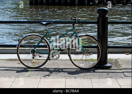 Bicycle chained to railing on Quayside, Newcastle-upon-Tyne - Stock Photo