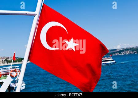 Turkey , Istanbul , Kabatas , Bosphorous or Bogazi , Turkish flag flying on tourist pleasure boat or ship or launch - Stock Photo