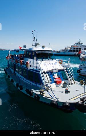 Turkey , Istanbul , Kabatas , Bosphorous or Bogazi , ferry boat landing at quay full of passengers - Stock Photo
