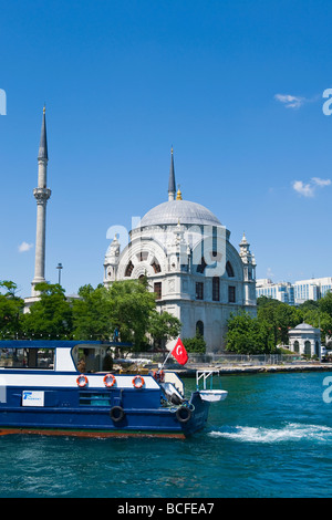 Turkey , Istanbul , Bosphorous or Bogazi , Kabatas , view of the Dolmabahce Camii or Mosque with boat in foreground - Stock Photo