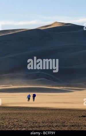 Tourists walking near Star Dune (750ft/250m), Great Sand Dunes National Park, Colorado, USA - Stock Photo