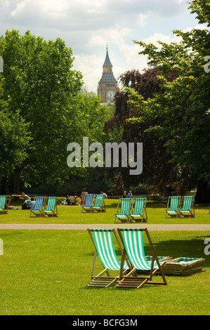 Empty deckchairs in St. James Park, London England. Big Ben is seen in the background. - Stock Photo