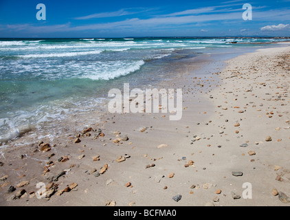 Waves and shallows on beach with rocks Platja des Trenc Mallorca Spain - Stock Photo