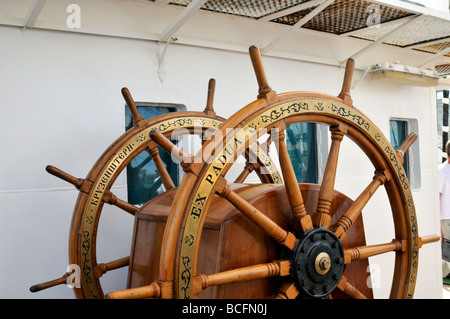 Twp wooden steering wheels of a sailing ship - Stock Photo