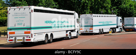 Three Heronden International Horse Transport lorries in convoy driving out of Hyde Park London - Stock Photo