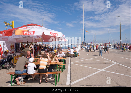 People relax in a bar on Kosciuszko Square by the marina Gdynia Poland - Stock Photo