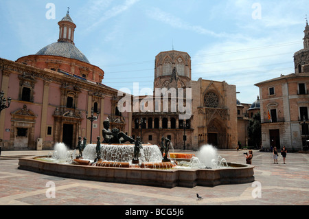 Square Plaza De La Virgen and el Miguelet tower in the old quarter close to Valencia Cathedral, Valencia, Spain - Stock Photo