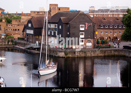 The Dickens Inn and a yacht at St Katharine Docks marina London - Stock Photo