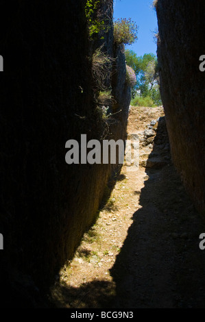 Entrance to tomb in Mycenaean Cemetery carved from solid rock in 1500BC at Mazarakata on the Greek island of Kefalonia - Stock Photo