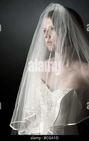 Low Key Shot of an Upset Bride - Stock Photo