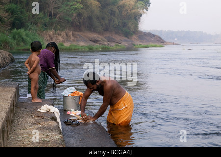 Washing laundry in river - Stock Photo