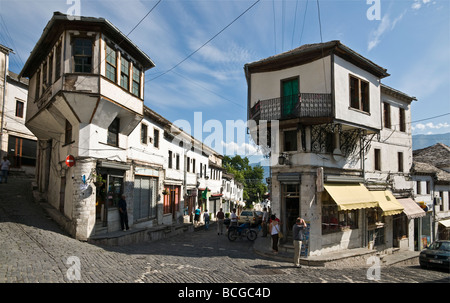 In the centre of the bazaar area of Gjirokastra in southern Albania with its old ottoman influenced houses - Stock Photo