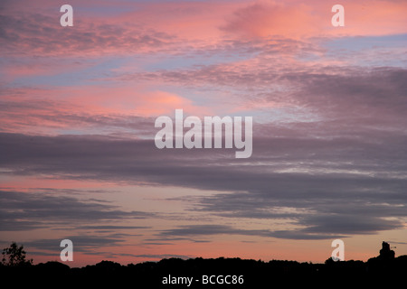 Colourful sunset cirrus clouds in pink and grey - Stock Photo