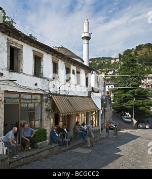 Cafes linning the street in the centre of the bazaar area of Gjirokastra in southern Albania - Stock Photo