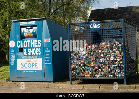 Clothes and shoes charity recycling bin and aluminium can recycling point in England - Stock Photo