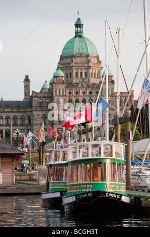 Victoria, British Columbia. Small ferry boats shuttle tourists around the inner harbor to hotels and various attractions. - Stock Photo