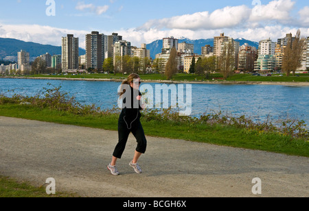 Woman jogging in Vanier park Vancouver - Stock Photo