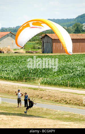 A paraglider landing at an airshow in France - Stock Photo