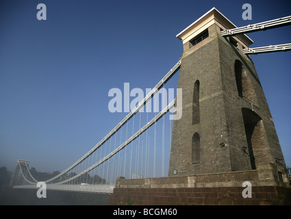 Brunel's Clifton Suspension Bridge over the Avon gorge Bristol in morning mist - Stock Photo