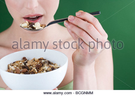 A woman eating muesli, close-up - Stock Photo