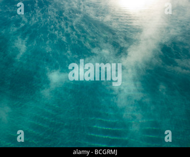 steam rising from warm water - Stock Photo