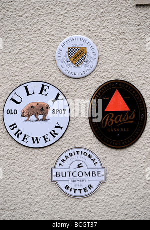 BREWERY SIGNS ON THE OLD SPOT INN A TRADITIONAL PUB IN DURSLEY GLOUCESTERSHIRE ENGLAND UK - Stock Photo