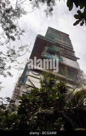 The construction of Mukesh Ambanis new private residential skyscraper named Antilia in Mumbai (Bombay) in India - Stock Photo