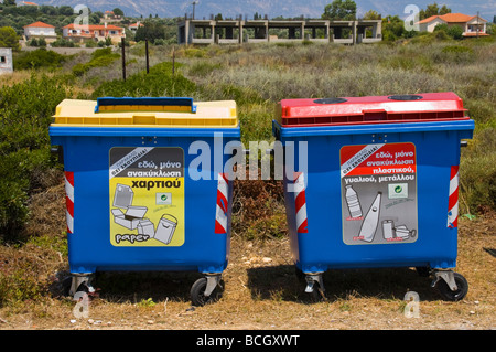 Large recycling bins for paper plastic and metal at Ammes beach on the Greek island of Kefalonia Greece GR - Stock Photo