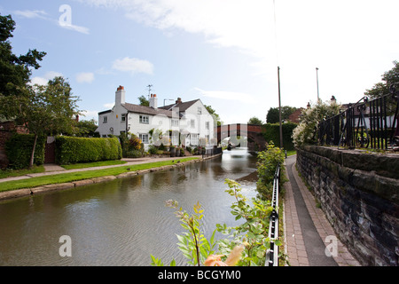 Canal and boats in Lymm, Warrington, Cheshire, England - Stock Photo