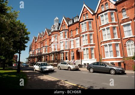 The exterior of the red brick Victorian era Glan Usk hotel Llandrindod Wells Powys UK - Stock Photo