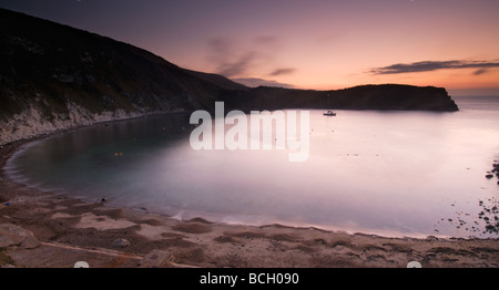 Dawn breaking over Lulworth Cove on the Isle of Purbeck South Dorset South West England UK - Stock Photo
