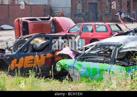 Wrecked cars in Barrow in Furness Cumbria UK - Stock Photo