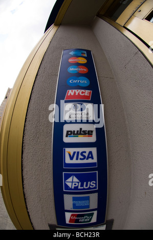 Logos for credit and debit cards in the lobby of a ...