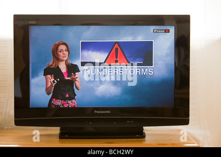 A TV weather forecast forecasting a thunderstorm in the UK - Stock Photo