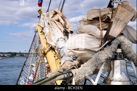 Bowsprit sails and bell on Russian Tall Ship Kruzenshtern - Stock Photo