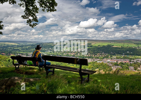 Enjoying the view of Ilkley from the Moor, Yorkshire UK - Stock Photo