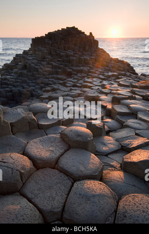 Sunset and Columnar Basalt, Giant's Causeway , World Heritage Site, County Antrim, Northern Ireland - Stock Photo