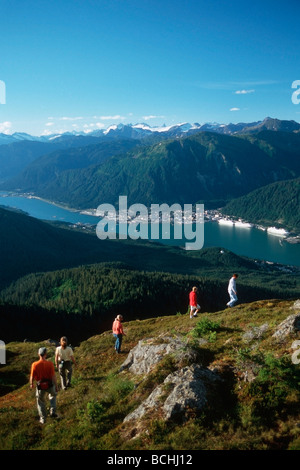Hikers on Ridge in Tongass NF Overlooking Juneau AK SE Summer - Stock Photo