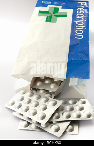Pills in a NHS prescription bag - Stock Photo
