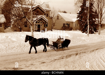 People on Sleigh Ride in Front of House Anchorage AK - Stock Photo