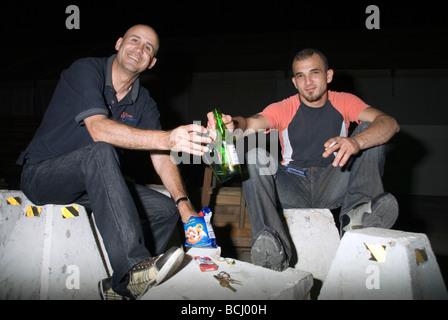 young Lebanese drinking beer Saturday night Beirut Lebanon