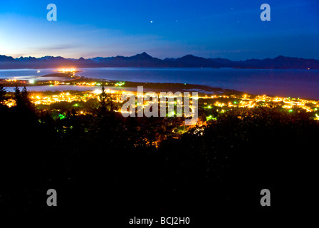 Early morning view of the Homer Spit, Kenai Mountains and Kachemak Bay on the Kenai Peninsula of Southcentral Alaska - Stock Photo