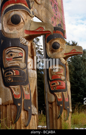 Pair of Totems in Kake Southeast AK summer portrait - Stock Photo